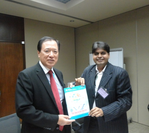 Dr Vinod Singh presenting the first copy of the magazine to H.E. Mr. Shun Ichi Murata, Deputy Executive Secretary, United Nations ESCAP