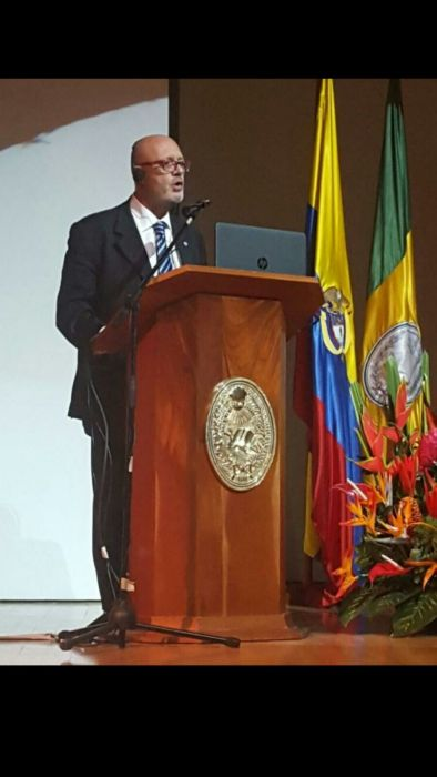 Prof. Bertirotti speaking at External University of Bogota during a seminar.